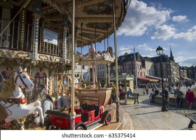 HONFLEUR, FRANCE - SEP 17: The Merry go-around at the port of Honfleur in Normandy, France on September 17 2015. Honfleur is a village of fishermen and a popular tourist attraction in Normandy
