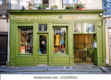 HONFLEUR, FRANCE - September 06, 2017: Street view with beautiful store front with clothes in Honfleur old town, normandy region in France