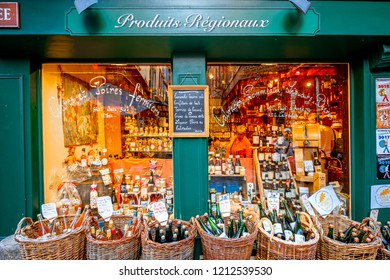 HONFLEUR, FRANCE - September 06, 2017: Street view with beautiful store front with drinks in Honfleur old town, normandy region in France