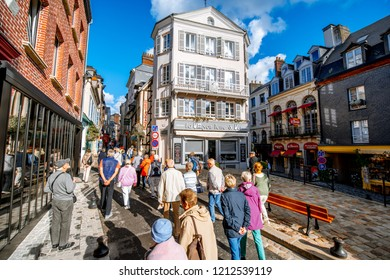 HONFLEUR, FRANCE - September 07, 2017: Street view with old buildings and tourists in Honfleur, famous french town in Normandy