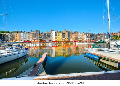 Honfleur, France - September 17 2018: Honfleur, France, the historic fishing village on the coast of Normandy with it's rows of sidewalk cafes and sailboats and yachts in the old pier