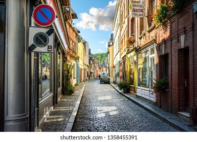 Honfleur, France - September 19 2018: A picturesque street of shops and apartments in the fishing village of Honfleur, France on the Normandy Coast of the English Channel.