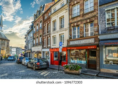 Honfleur, France - September 20 2017: Quaint street in the Normandy town of Honfleur France with Saint Catherine's church in the distance on a sunny day in early autumn