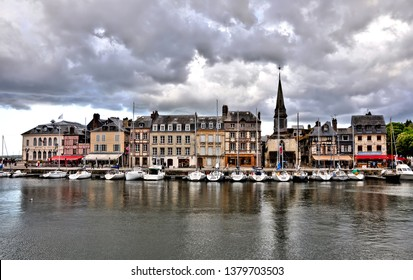 Honfleur harbour and houses with slate-covered frontages. Honfleur. Normandy. France.  The picturesque city- famous for its history and art traditions- major tourist destination in France. 2014-04-26.