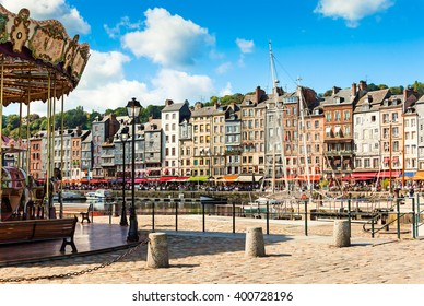 Honfleur, Normandy; Carousel and Restaurants near the historic Harbour