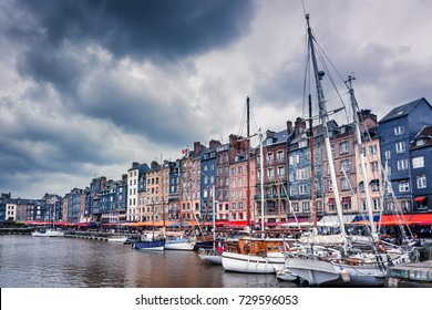 Honfleur, Normandy, France. Boats and colored buildings