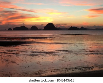Hong Island Sunset - Stunning orange and salmon hues at sunset, on the beach at low tide, overlooking the Hong Islands, Thailand