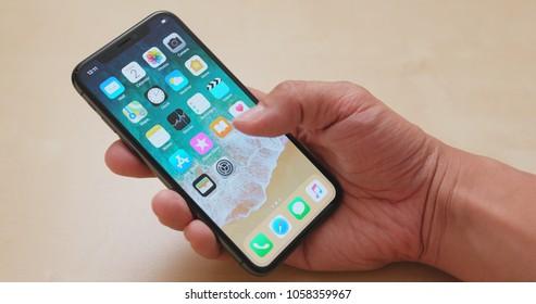 Hong Kong, Hong Kong, 01 March 2018:- Using iphoneX