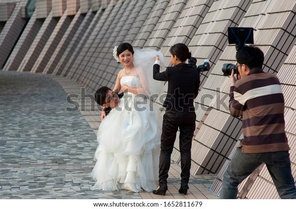 Hong Kong, Hong Kong. 01/24/2013 Wedding photo session in Hong Kong.  Happy newlyweds. Editorial.