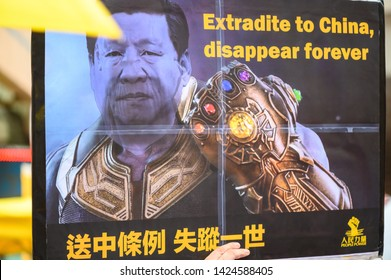Hong kong - 09 JUN 2019: 1.03 million Hongkongers are protesting against China extradition law. The banner is a photoshop image with Thanos and Xi Jinping.