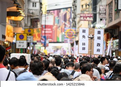 Hong Kong - 09 JUN 2019: 1.03 million citizen are protesting against China extradition law. Chinese translation: Carrie Lam, step down. Reorganize government.