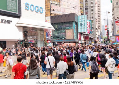 Hong Kong - 09 November, 2018 : People walking across Hennessy Road, Causeway Bay in front of a big department store SOGO.