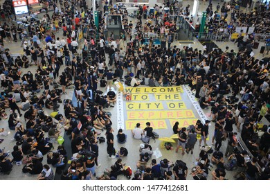 Hong Kong -11 August 2019: million of protesters sit to the international airport . hong kong people oppose a controversial extradition bill which may include china.