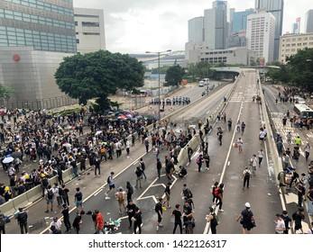 Hong Kong -12 June 2019: crowd run away after the police release Tear bomb. After the protesters on June 9 to oppose a controversial extradition bill, government say no change will do in such case.