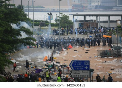 Hong Kong -12 June 2019: riot police release tear gas to unarmed protesters . hong kong people oppose a controversial extradition bill which may include china.