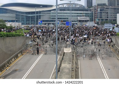 Hong Kong -12 June 2019: the crowd retreat after the tear gas are released. people oppose a controversial extradition bill which may include china