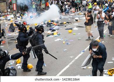 Hong Kong 12th June 2019: Anti Extradition Bill Protest.  Riot Police firing pepper spray  the air is full of tear gas during clashes with protesters outside  Central Government Office in Hong Kong