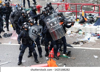 Hong Kong 12th June 2019: Anti Extradition Bill Protest.  Riot police aim a tear gas gun directly at protesters during clashes with protesters outside the Central Government Office in Hong Kong.