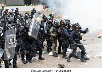 Hong Kong 12th June 2019: Anti Extradition Bill Protest. Riot police bunch up next to a cloud of tear gas during clashes with protesters outside the Central Government Office in Hong Kong.