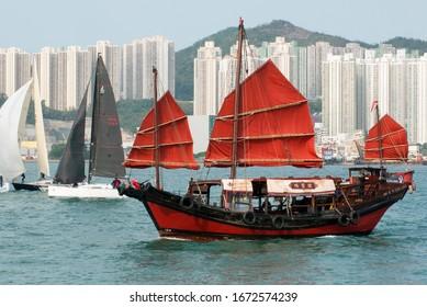 Hong Kong, 14 March 2020: Chinese traditional sailing boat for tourist sightseeing in Hong Kong.