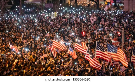 Hong Kong 14 Oct 2019: Hong Kong protesters fill Chater Garden, wave American flags and spill onto nearby roads in Central, calling for United States to pass Hong Kong Human Rights and Democracy Act