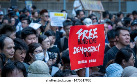 Hong Kong - 14Jul2019: Hongkongers march in Sha Tin against Hong Kong's extradition bill, unprecedented violence by riot police pepper sprayed protesters. Banner: Free Hong Kong, Democracy now.