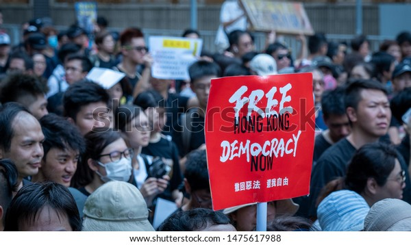 Hong Kong - 14Jul2019: Hongkongers march in Sha Tin against Hong Kong's extradition bill, unprecedented violence by riot police pepper sprayed protesters. Banner: Free Hong Kong, Democracy now.