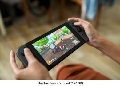 Hong Kong, 16 May 2017 -:Woman playing Nintendo Switch at home