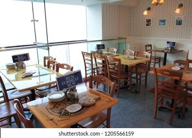 Hong Kong 18 Oct 2018 - Waiter is preparing Bubba Gump restaurant in the Peak Hong Kong before the guest coming during summer season