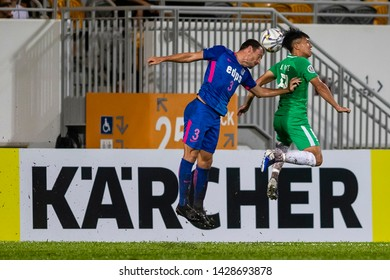 Hong Kong - 19 June 2019: Daniel Cancela Rodriguez (L) of Kitchee fights for the ball with Lee Ka Yiu (R) of Wofoo Tai Po during the AFC Cup 2019 Group Stage match between Wofoo Tai Po and Kitchee.