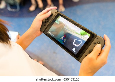 Hong Kong, 19 May 2017 -:Playing mario kart 8 on Nintendo Switch inside training compartment