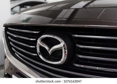 Hong Kong, Hong Kong - 25 April 2018: Close-up of Mazda logo badge and car grill on grey Mazda 6 luxury sports sedan.