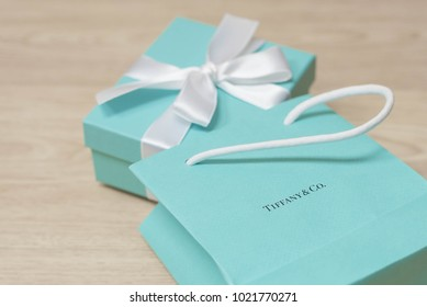 HONG KONG - 26 JANUARY 2018: Signature Tiffany & Co. Blue Box - brand package of luxury jewelry brand Tiffany and Co. on a wood texture background, HONG KONG, 26 January 2018
