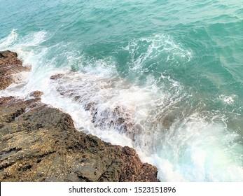 Hong Kong, 29th September, 2019: Calm moving blue sea water, wave and rocks at Ap Lei Pai (Ap Lei Chau, South HK island)