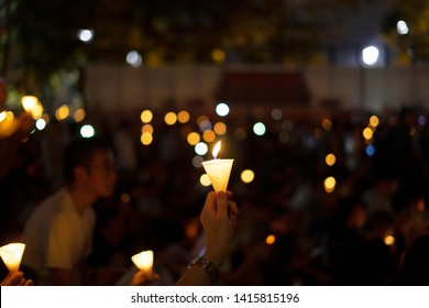 HONG KONG, 4 JUNE, 2019: A candle light in the vigil. Large crowds turned out at the Victoria Park in Hong Kong Island attending a candlelight vigil for the 30th anniversary of Tiananmen crackdown.