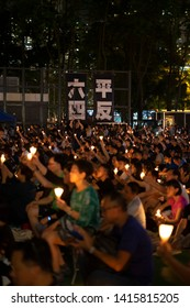 HONG KONG, 4 JUNE, 2019: Large crowds turned out at the Victoria Park in Hong Kong Island attending a candlelight vigil for the 30th anniversary of Tiananmen crackdown.