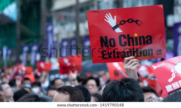 """Hong Kong - 9Jun2019: 1.03 million HKers join protest against proposed extradition law that will allow transfer of fugitives from HK to China. Translation on banner: """"Withdraw the extradition law!"""""""
