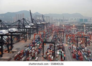 HONG KONG - Apr 18, 2016: Containers at Hong Kong commercial port Hong Kong, China. Hong Kong is one of several hub ports serving more than 240 million tonnes of cargo during the year.
