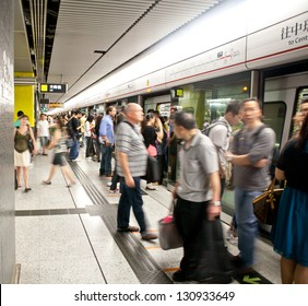 HONG KONG - APRIL 10: People waiting train  MTR underground in the Hong Kong on April 10 2011. Mass Transit Railway is rapid system in Hong Kong that is a common mode of public transport.