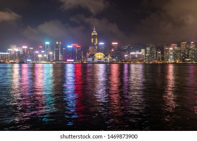 Hong kong - April 11, 2019 : hong kong city with victoria harbour at night before the symphony of lights. view from avenue of stars