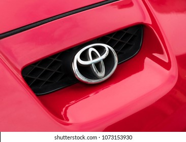 Hong Kong: April 13, 2018: Sign of a Toyota logo on red car. Toyota Motor Corporation is a Japanese multinational automotive manufacturer headquartered in Toyota, Aichi, Japan.