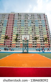 Hong Kong - April 15 2019: Choi Hung Estate Car Park, narrow apartments in the public housing estate in Hong Kong, with a basketball court. Most popular place for tourists, people taking pictures