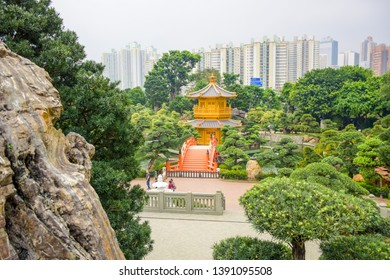 HONG KONG - APRIL 16, 2019: Tourists visiting Nan Lian Garden, a Chinese classical garden in Diamond Hill with hills,  trees, rocks and wooden structures, Hong Kong