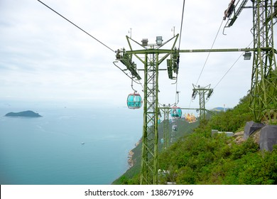 HONG KONG - APRIL 17: Tourists taking cable cars back and forth between The Waterfront and The Summit in Hong Kong Ocean Park, a very famous tourist destination in Hong Kong