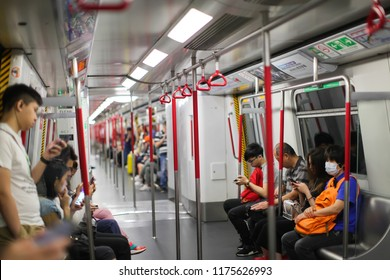 HONG KONG - April , 2018: inside a MTR train. The Mass Transit Railway is the rapid transit railway system in Hong Kong. It is one of the most profitable systems in the world