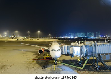 HONG KONG - APRIL 22: Boeing 737 docked in airport on April 22, 2014 in Hong Kong. Hong Kong International Airport  is one of the best airport in the annual passenger survey by Skytrax.