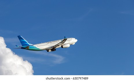 HONG KONG - APRIL 23, 2017: Garuda Indonesia airplane departing from the Hong Kong International Airport. Garuda Indonesia is the national airline of Indonesia.