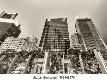 HONG KONG - APRIL 3, 2014: Black and white modern skyline at night. Hong Kong attract 30 million tourists every year.