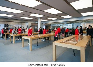 HONG KONG - April 8, 2018: Interior of The Apple Store with customers and employees in red uniform, IFC shopping mall, Hong Kong