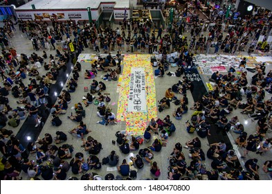 HONG KONG - AUG 10 2019: Protesters setting up Lennon Wall at Hong Kong International Airport telling the story of protests and police brutality to tourist and visitors